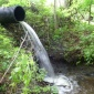 Culvert pouring water into a creek