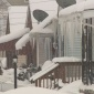Homes covered in snow and ice